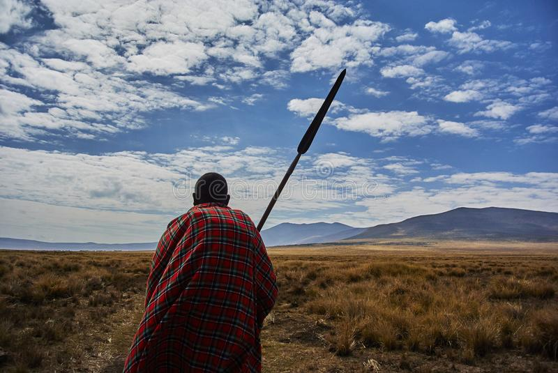 Masai guide hike in the mountains. Hike in Ngorongoro Conservation Area Nationnal park Highlands craters en route for Bulati Village from Nainokanoka with Masai stock image