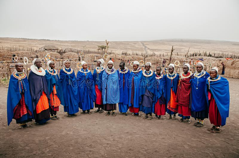 Masai or Maasai tribe woman in blue cloth wearing headpiece and ornaments. Ethnic group of Ngorongoro Consevation, Serengeti in stock photography