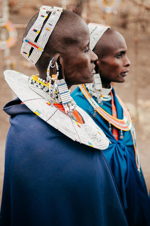 Masai or Maasai tribe woman in blue cloth wearing headpiece and ornaments. Ethnic group of Ngorongoro Consevation, Serengeti in royalty free stock photo