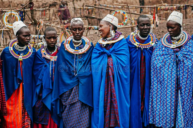 Masai or Maasai tribe woman in blue cloth wearing headpiece and ornaments. Ethnic group of Ngorongoro Consevation, Serengeti in stock photo