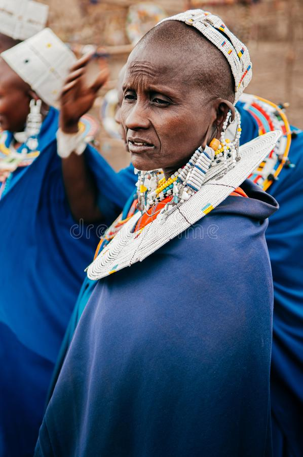 Masai or Maasai tribe woman in blue cloth wearing headpiece and ornaments. Ethnic group of Ngorongoro Consevation, Serengeti in stock image