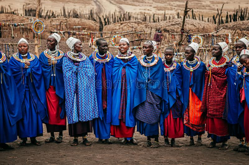 Masai or Maasai tribe woman in blue cloth wearing headpiece and ornaments. Ethnic group of Ngorongoro Consevation, Serengeti in royalty free stock image