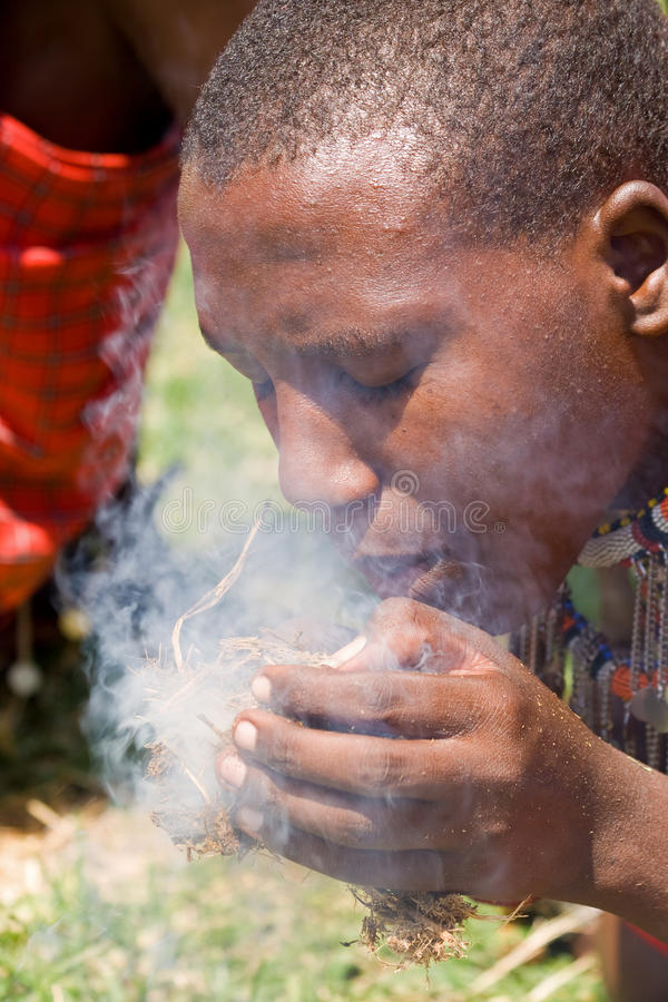 Masai making fire stock images
