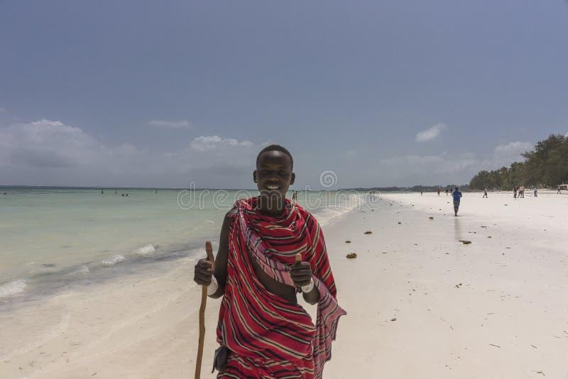 Masai man on the beach in Zanzibar stock photography