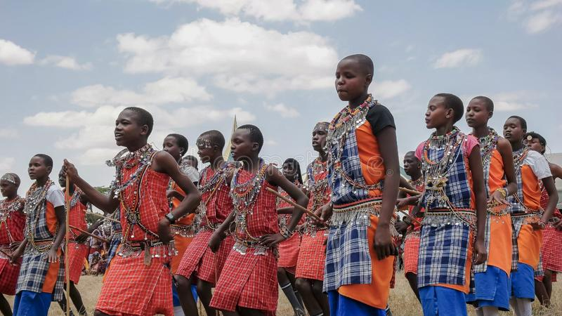 MASAI MARA, KENYA- 26, AUGUST, 2016: group of maasai boys dancing at koiyaki guiding school graduation in kenya stock images