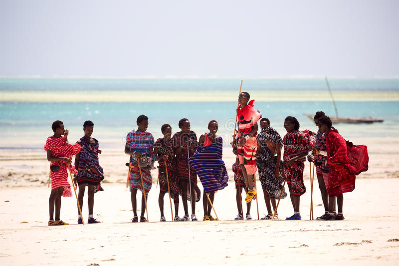 Masai men dance. Zanzibar, Tanzania - January 11, 2017: Masai men jumping in traditional clothes at beach in Kiwengwa, Zanzibar island, Tanzania, Africa royalty free stock photography