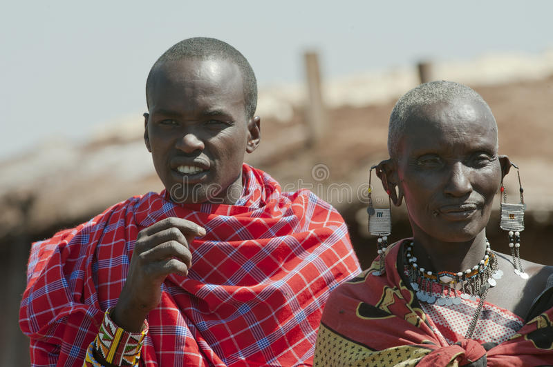 Masai Mother and Son with typical red colored fabric, Tanzania royalty free stock image