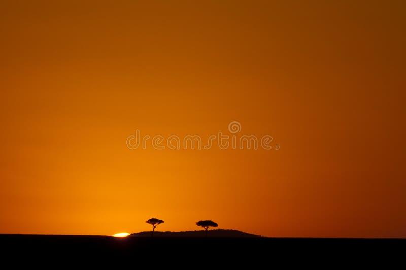 Masai sunrise. Start of a new day sunrise over the masai mara kenya stock images