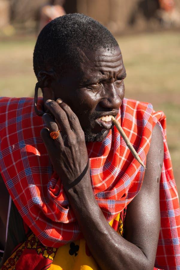 Masai tribesman shows off earlobe hole royalty free stock image