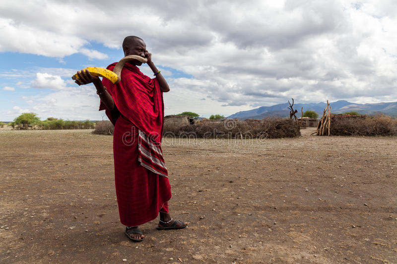Masai warrior. Africa. Tanzania. Massai village. Massai warrior playing traditional horn