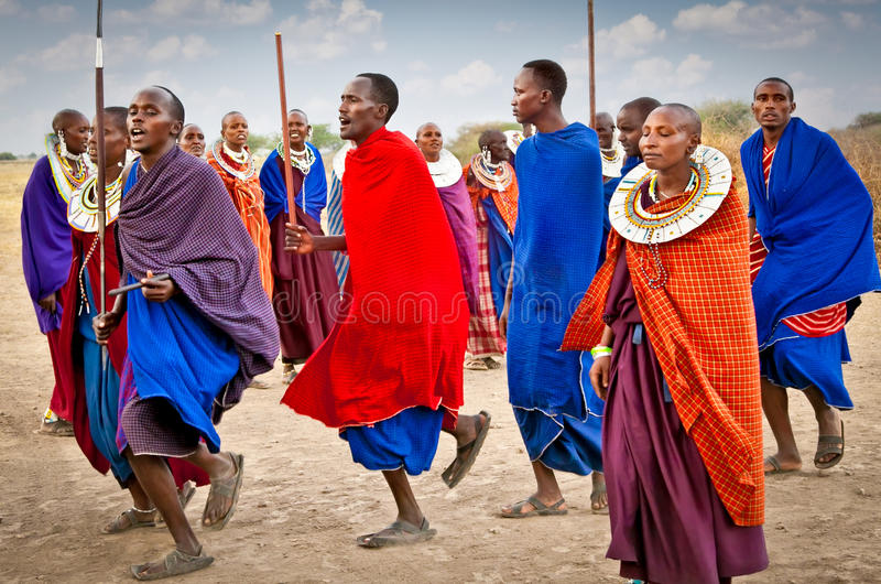 Masai warriors dancing traditional jumps as cultural ceremony, T royalty free stock photo