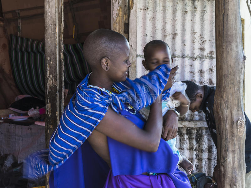 Masai woman with baby royalty free stock photo