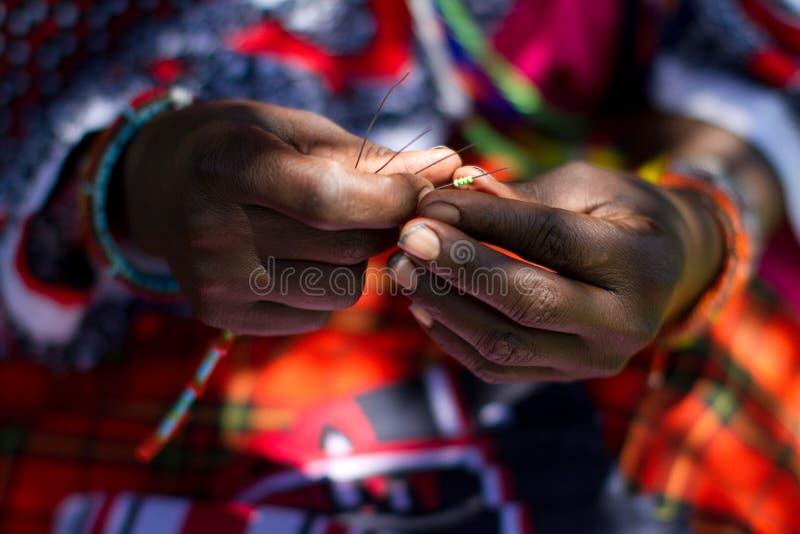 Masai woman beading stock photos