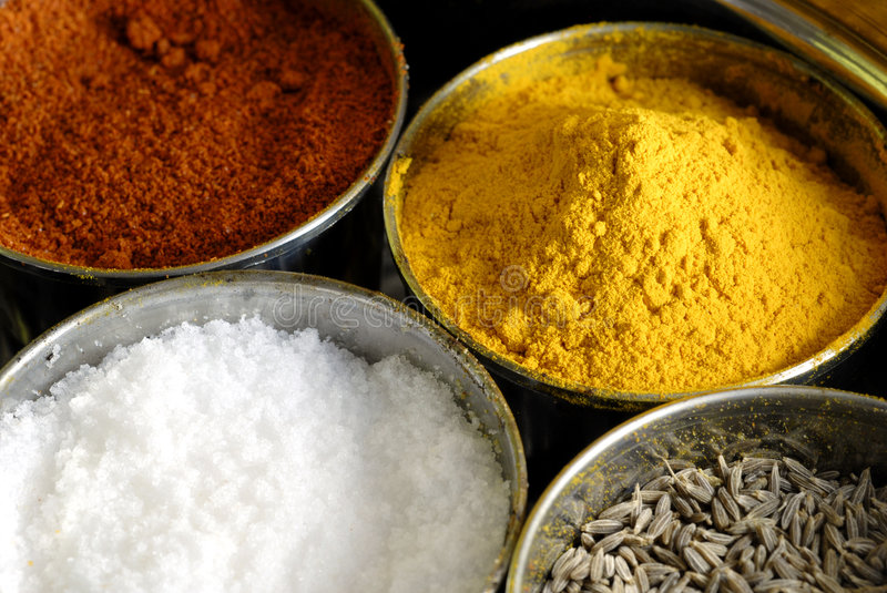 Masala Assorted Condiments and Spices Box. A container holding a variety of condiments and spices used in cooking stock photography