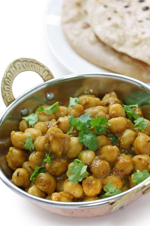 Masala de Chana, caril do grão-de-bico, prato indiano imagem de stock