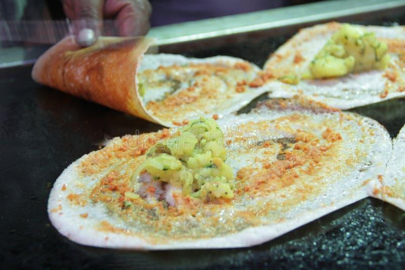 Masala Dosa - un pancake dall'India del sud immagine stock libera da diritti