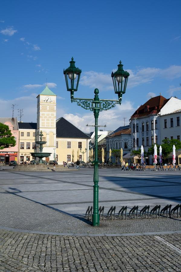 Masaryk square, Karvina, Czech Republic / Czechia. Historical center in the town.  Old architecture , retro and vintage lantern, people stock photo