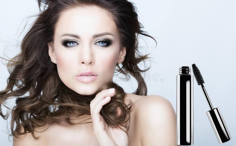 Mascara. Beauty face with a mascara beside royalty free stock photo