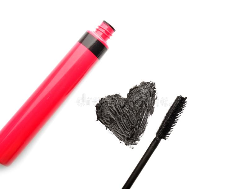 Mascara with drawn heart on white background royalty free stock photos