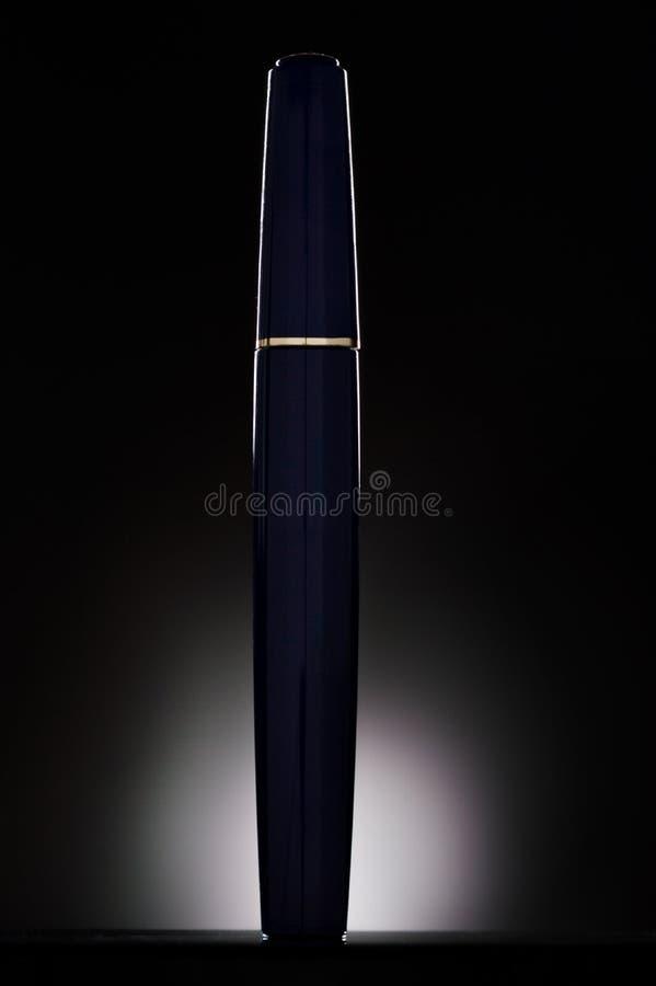 Mascara. Flacon of mascara on black background stock image