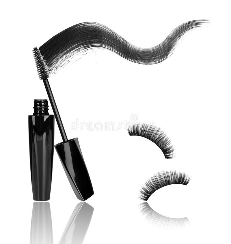 Mascara, wand applicator with black stroke and false eyelashes. Isolated on white background royalty free stock photos