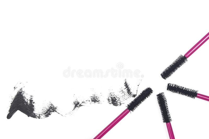 Mascara wands in bright pink and mascara stroke on white background. Mascara wands and mascara stroke on white background. The image can be used as a beautiful royalty free stock images