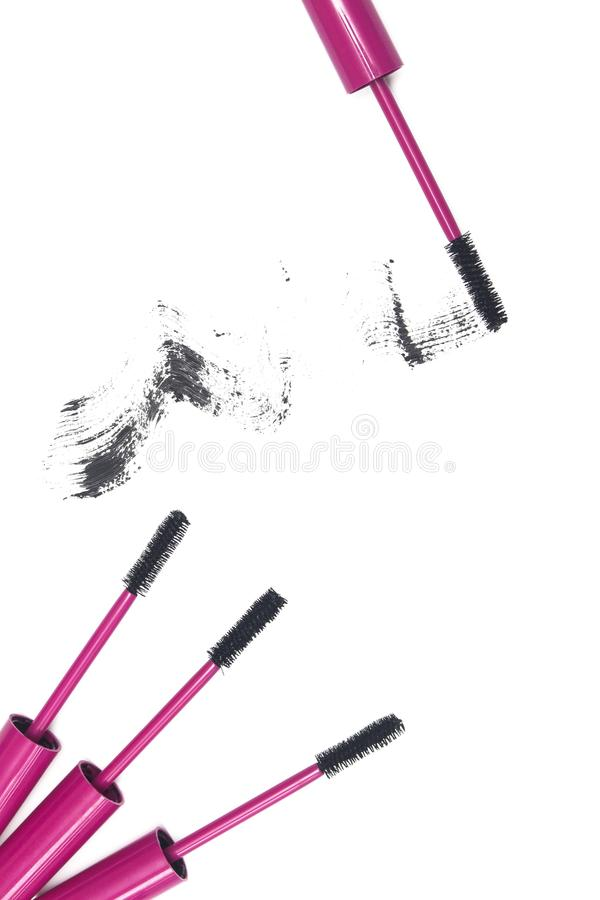 Mascara wands and mascara stroke on white background. The image can be used as a beautiful background for business cards, websites, and so on royalty free stock photography