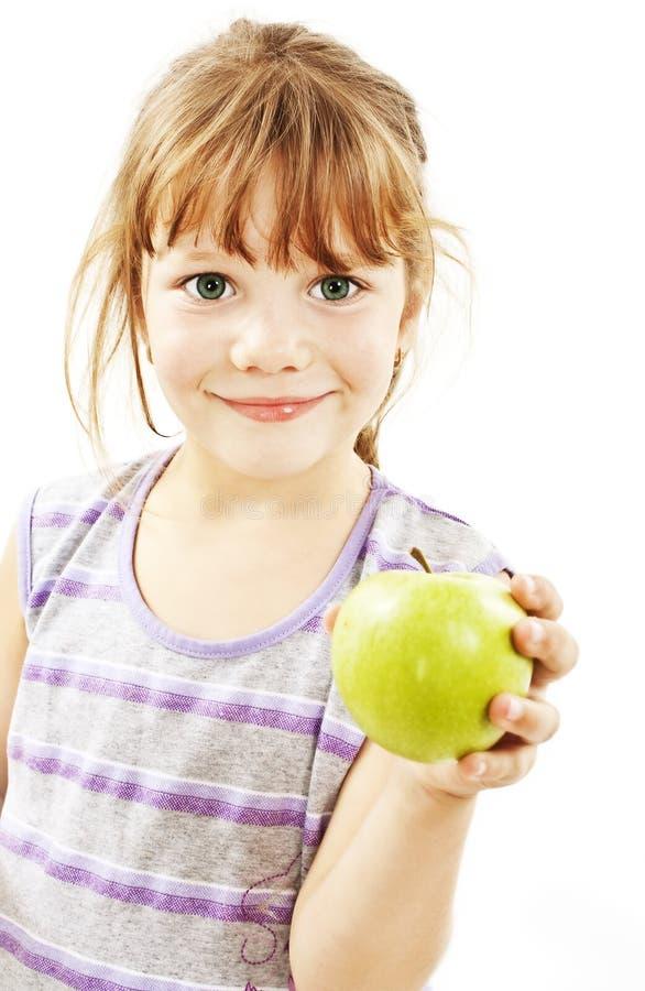 Maschera della bambina con la mela verde immagini stock libere da diritti