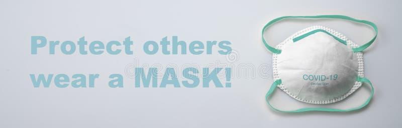 Maschera di protezione antivirus ffp2 standard per prevenire l'infezione da corona COVID-19 immagini stock