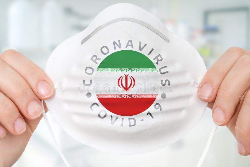 Maschera respiratrice con bandiera iraniana - Concetto Coronavirus COVID-19 immagini stock libere da diritti