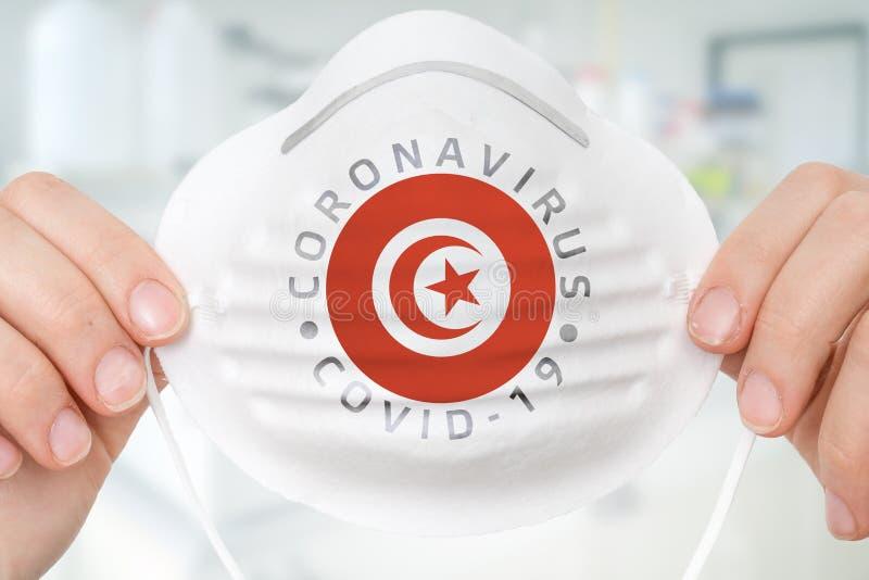 Maschera respiratrice con bandiera tunisina - Coronavirus COVID-19 conc immagine stock