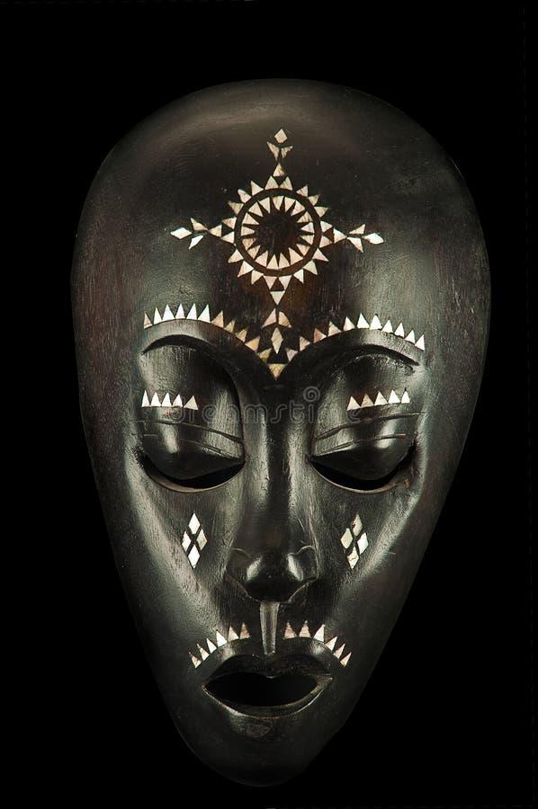 Mascherina africana isolata sul nero fotografie stock libere da diritti