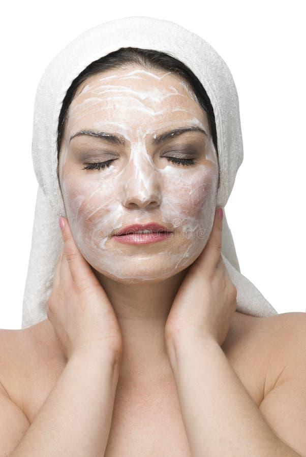 Mascherina della crema di fronte della donna fotografia stock libera da diritti