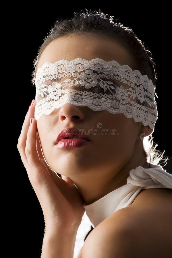 Mascherina e merletto bianco fotografia stock