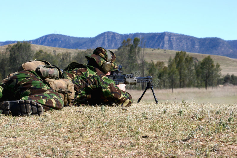 Maschinengewehr-Zündung lizenzfreie stockfotos