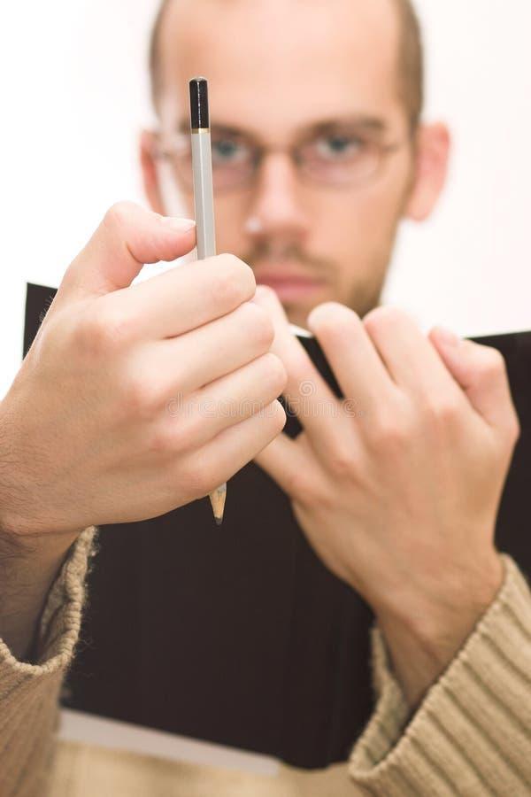 Maschio che misura con la matita immagini stock libere da diritti