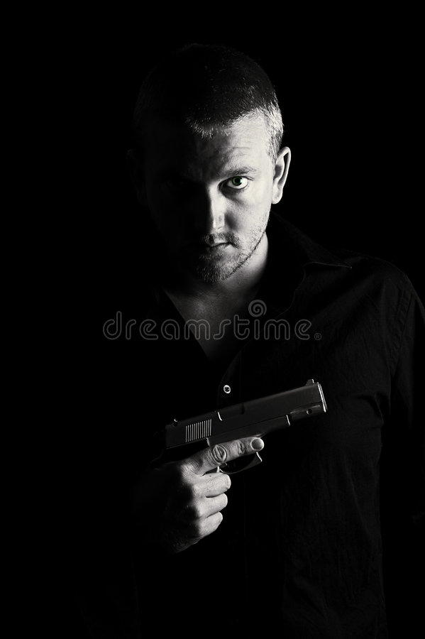 Maschio con la pistola fotografia stock