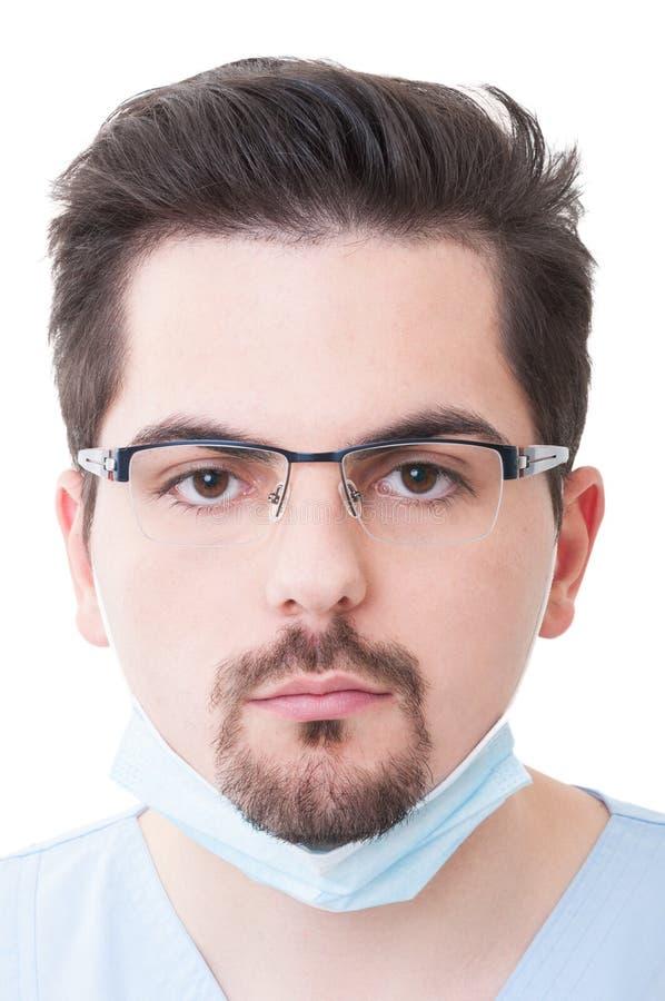 Maschio del dentista con un fronte serio immagini stock