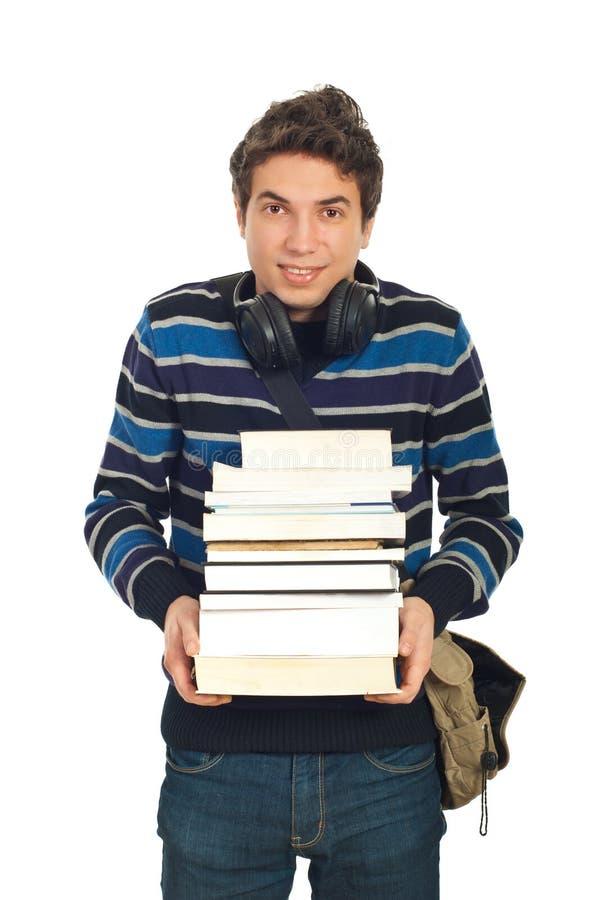 Maschio felice dell'allievo con i libri immagine stock