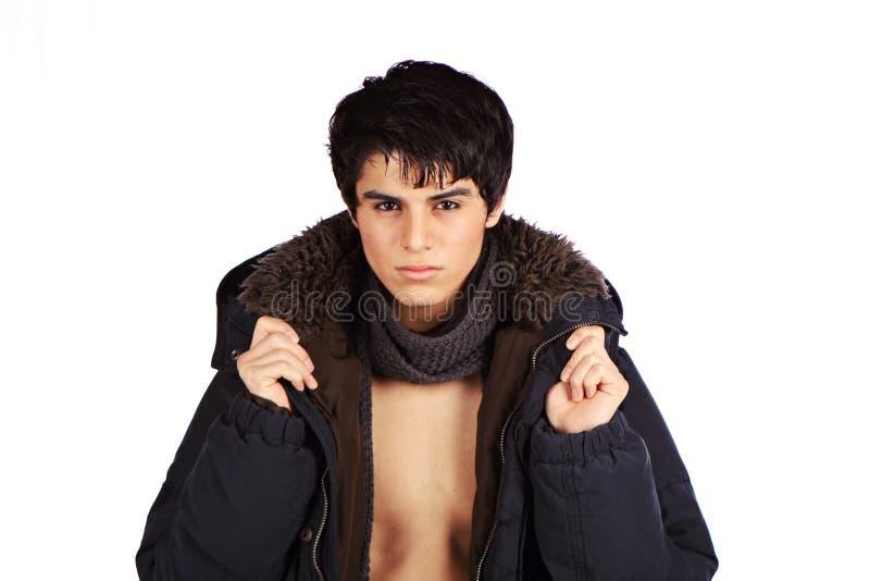 Maschio ispanico con il cappotto fotografia stock libera da diritti