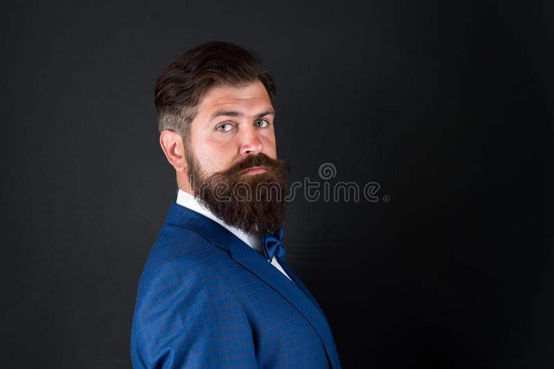 Masculine aesthetic. Few grooming life hacks help achieve great look, whatever occasion. Well groomed man beard in suit royalty free stock photography