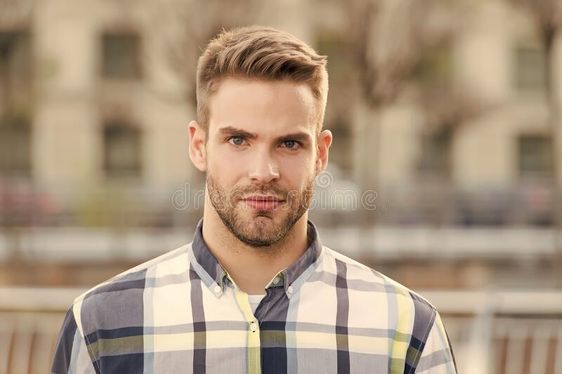 Masculine appearance. Handsome man unshaven face and stylish hair. Caucasian man urban background. Bearded man in casual stock photos