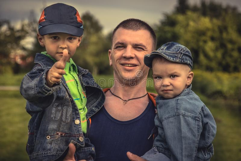 Masculine father sons family lifestyle portrait concept happy paternity royalty free stock photos