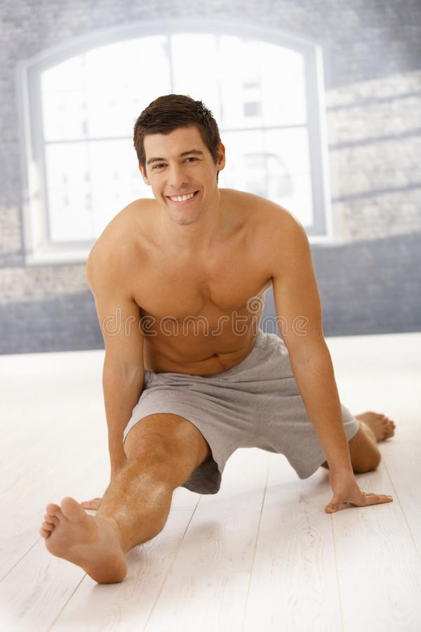 Download Masculine Guy Doing Forward Split In Gym Stock Photo - Image: 22047612