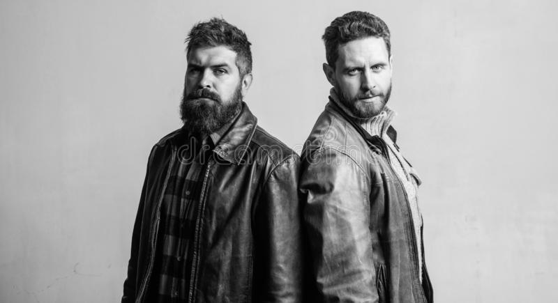 Masculinity and brutality. Feel confident in brutal leather clothes. Brutal men wear leather jackets. Men brutal bearded royalty free stock images