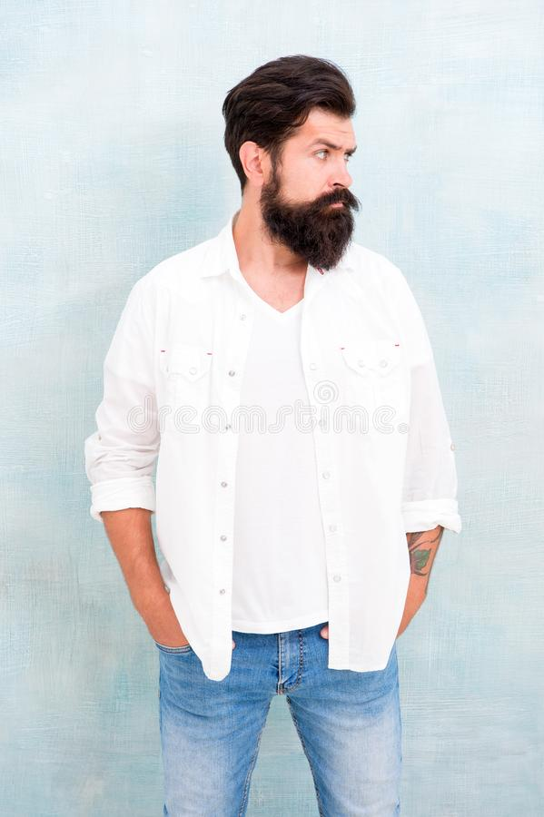 Masculinity concept. Hipster long beard and mustache. Male temper brutality. Brutal macho casual outfit gray background. Simple and casual. Casual style daily stock photos