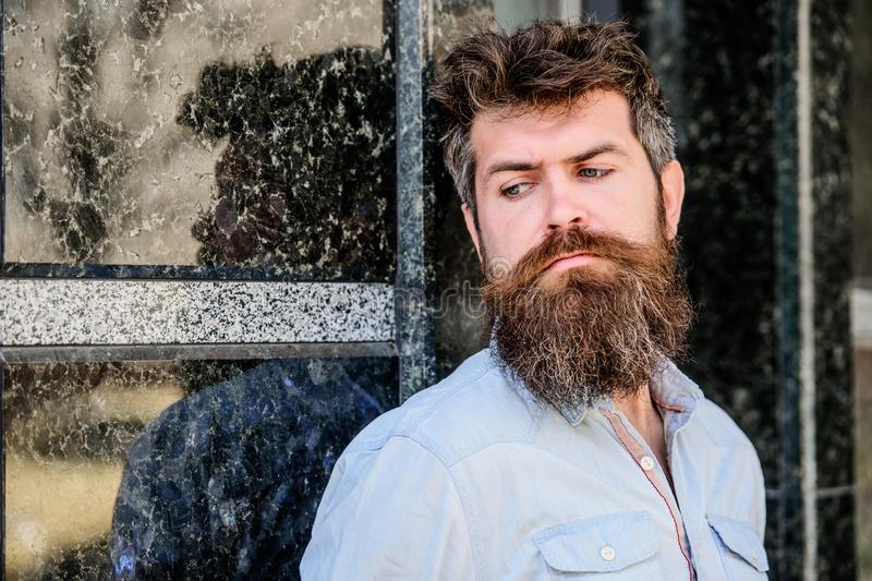 Masculinity and manliness. Confident posture of handsome man. Guy masculine appearance with long beard. Barber concept. Beard grooming. Beard care. Man royalty free stock photography