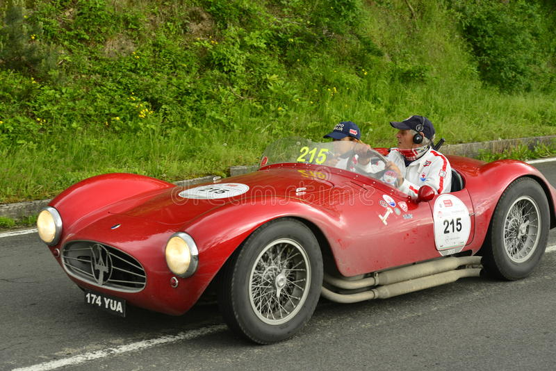 Maserati car running in Mille Miglia race stock image
