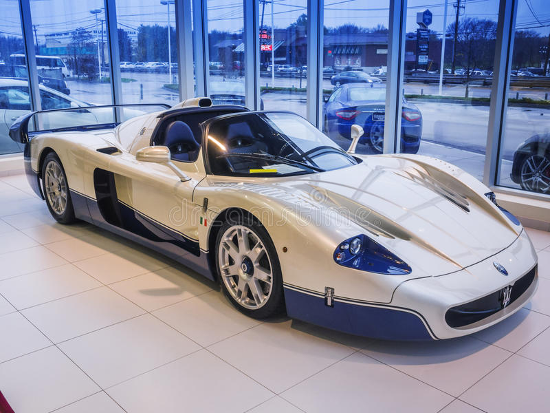 Maserati MC-12 race car. The Maserati MC12 is a limited production two-seater supercar produced by Italian car maker Maserati to allow a racing variant to stock photography