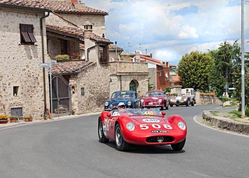 Maserati 200 SI 1957 runs in Mille Miglia 2014. COLLE DI VAL D'ELSA, SI, ITALY - MAY 17: unidentified crew on a vintage competition car Maserati 200 SI (1957) royalty free stock images